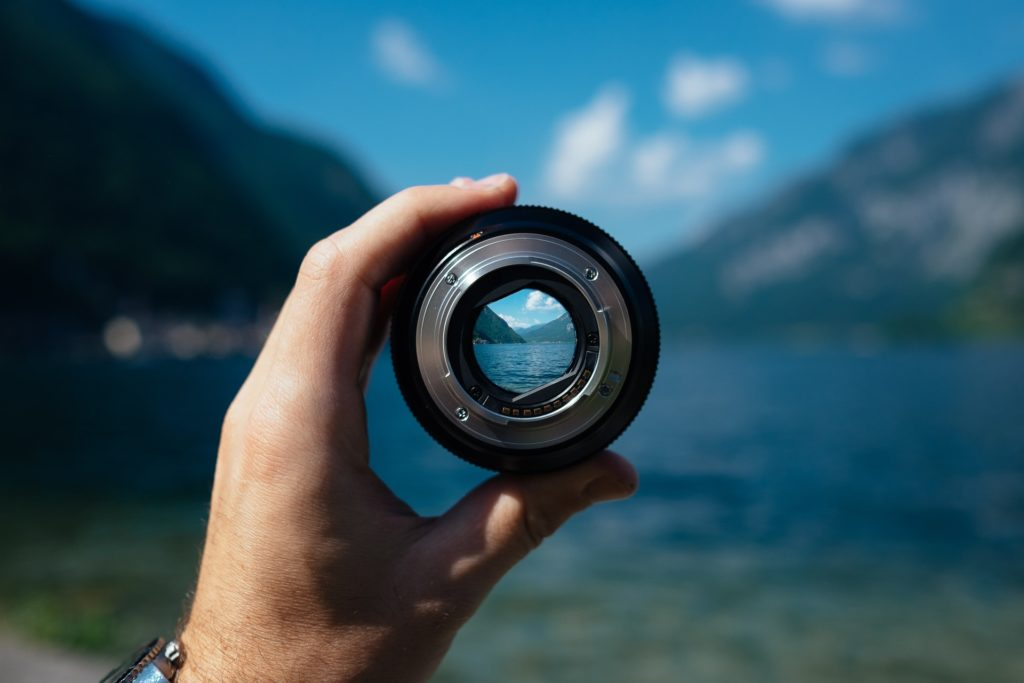 refocusing your life represented by camera lens and landscape